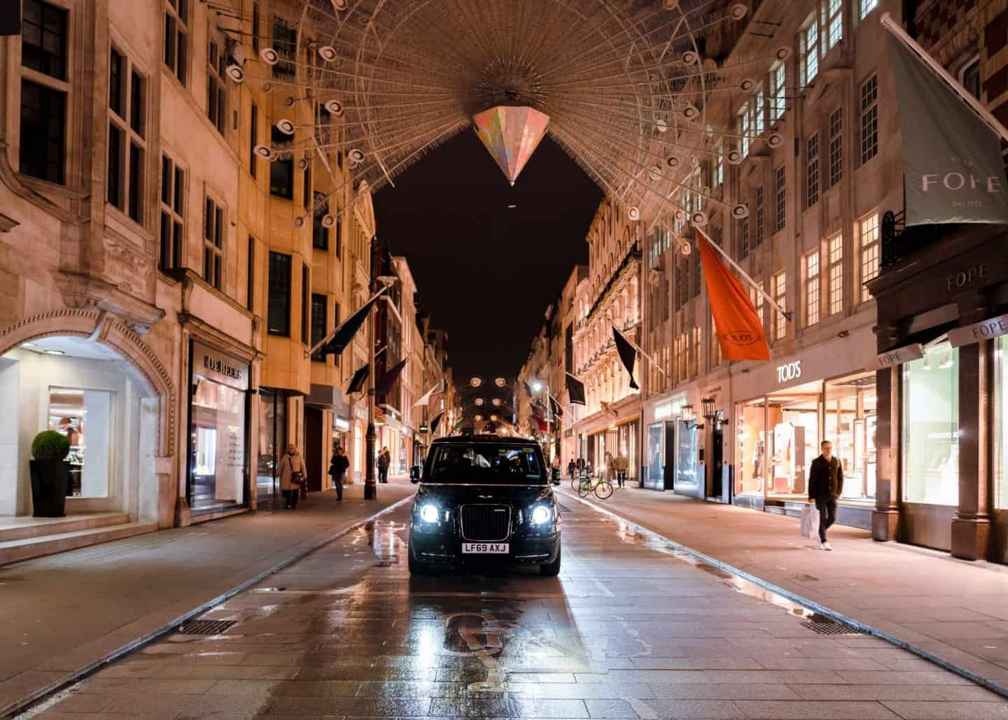 An iconic black taxi on Bond Street.  A fun way to explore London in 2 days