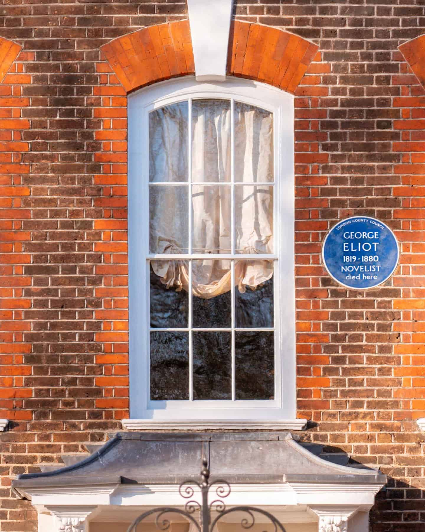 Close up image showing English heritage blue plaque for novelist George Eliot in Cheyne Walk, famous London street