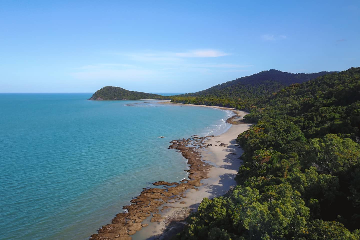 An aerial view of the beach at Cape Tribulation where the Daintree Rainforest meets the Great Barrier Reef