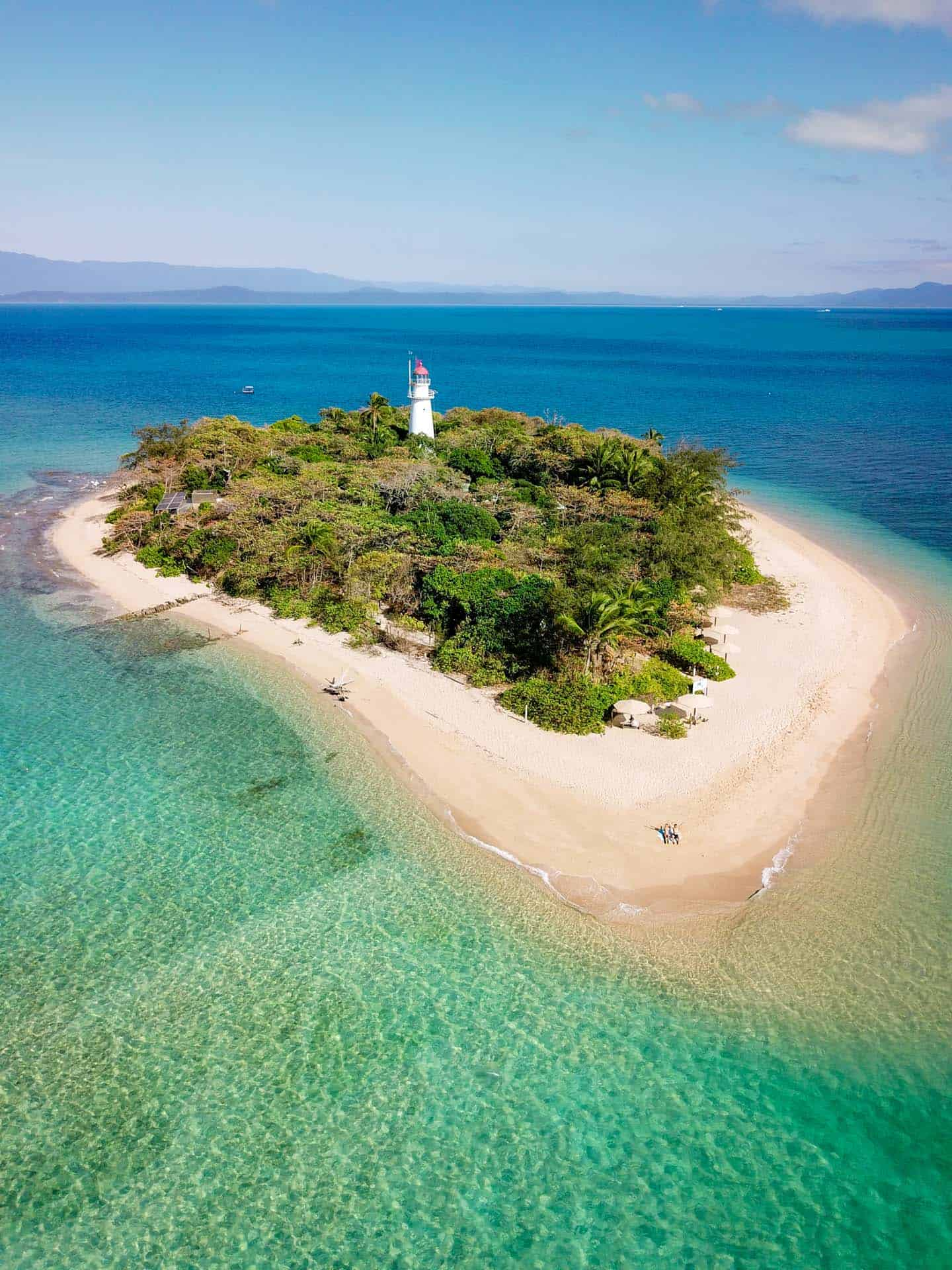 A couple on a deserted islaned.  An aerial photo of Low Isles, Port Douglas, Queensland, Australia.