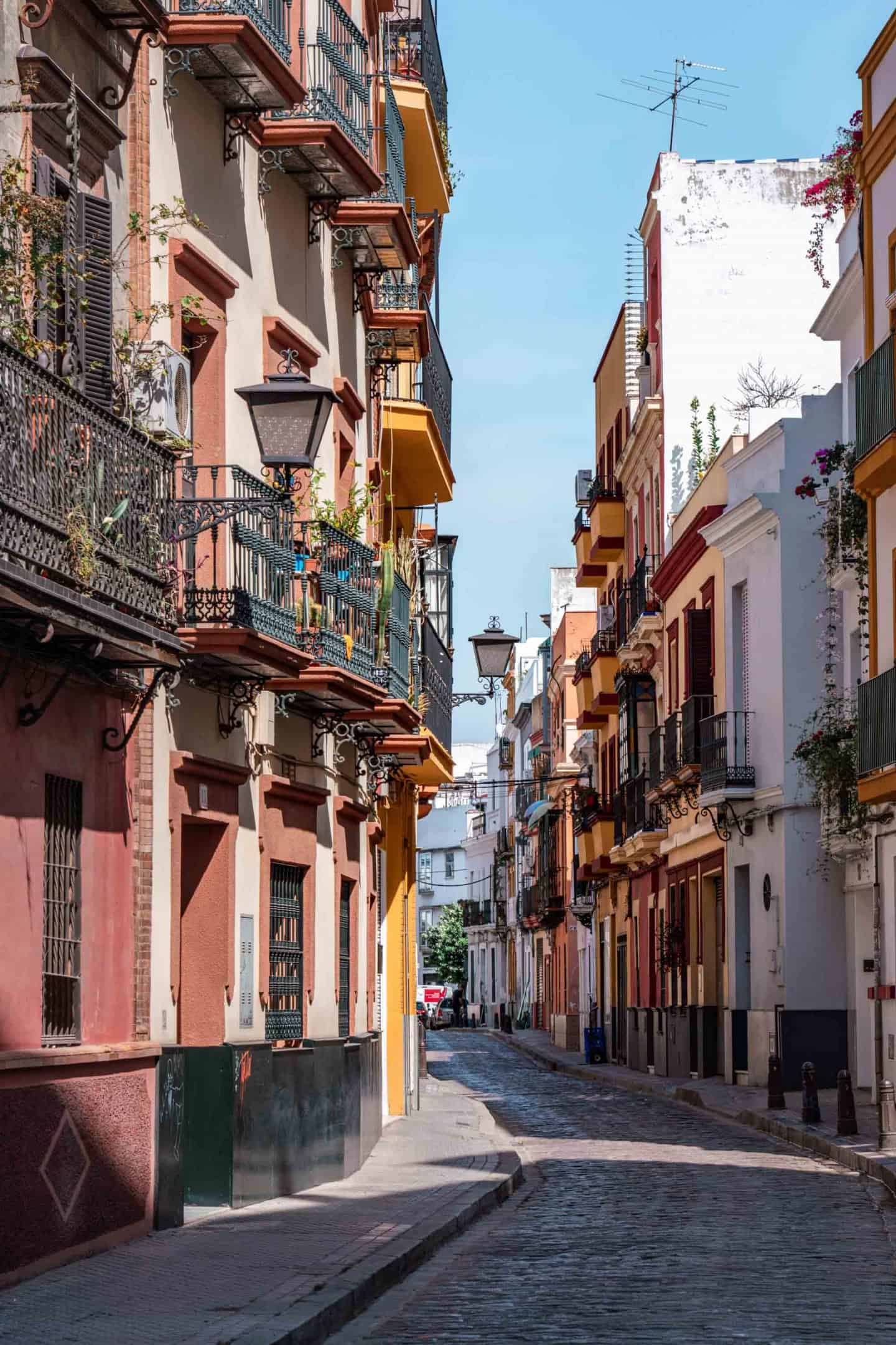 Colourful houses and flower adorned balconies line the cobbled streets of Seville