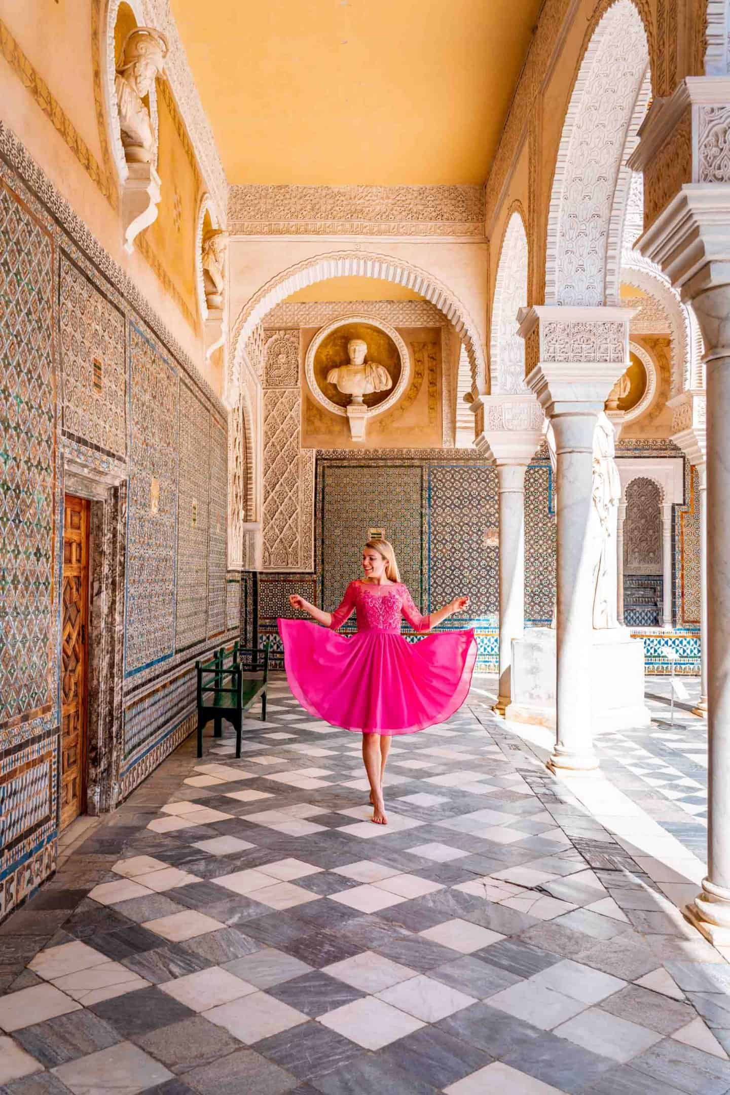 Girl in a pink dress in the courtyard of Casa de Pilatos Seville