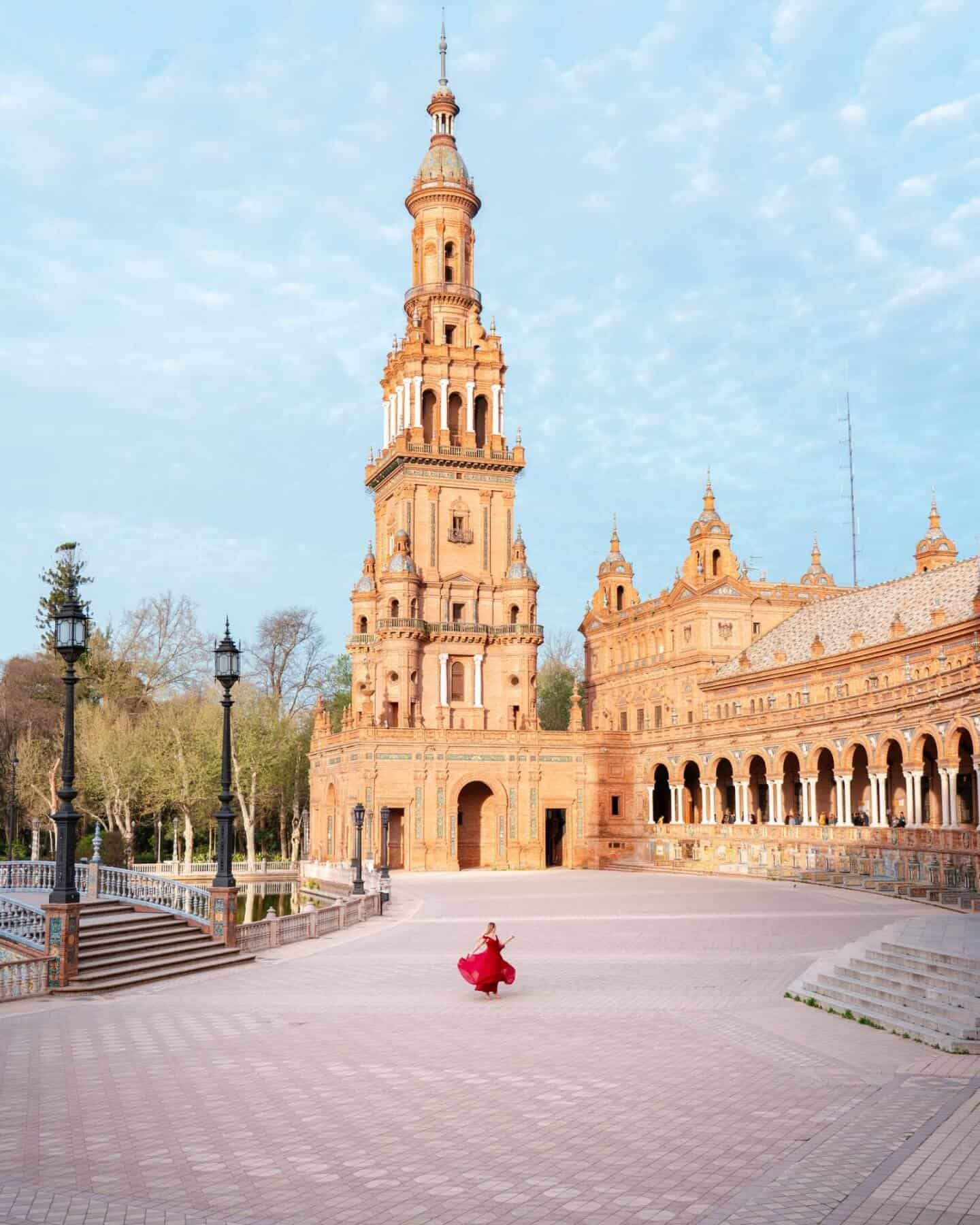 Plaza de España Seville empty except a girl in a red dress
