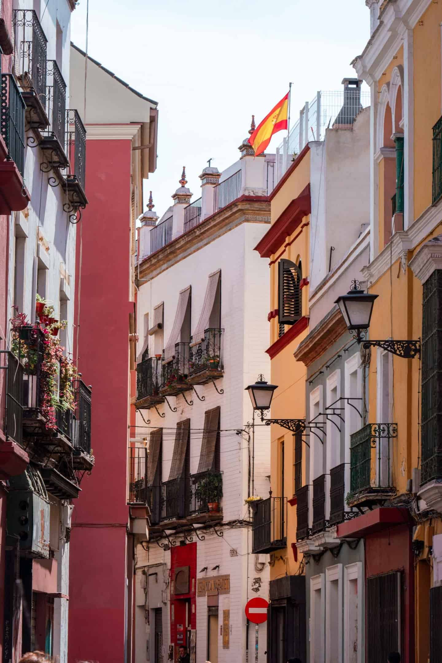 Red, white and yellow buildings at Plaza de Monte Sión Seville