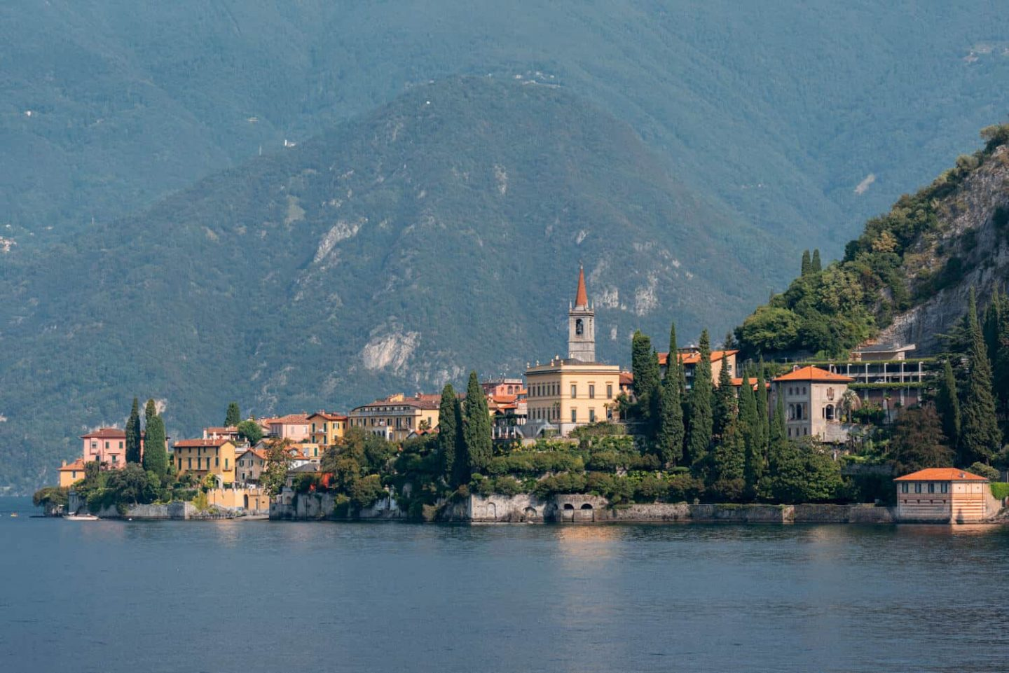 Colourful town of Varenna of Lake Como against a backdrop of mountains.  The most beautiful town on a day trip Milan to Lake Como