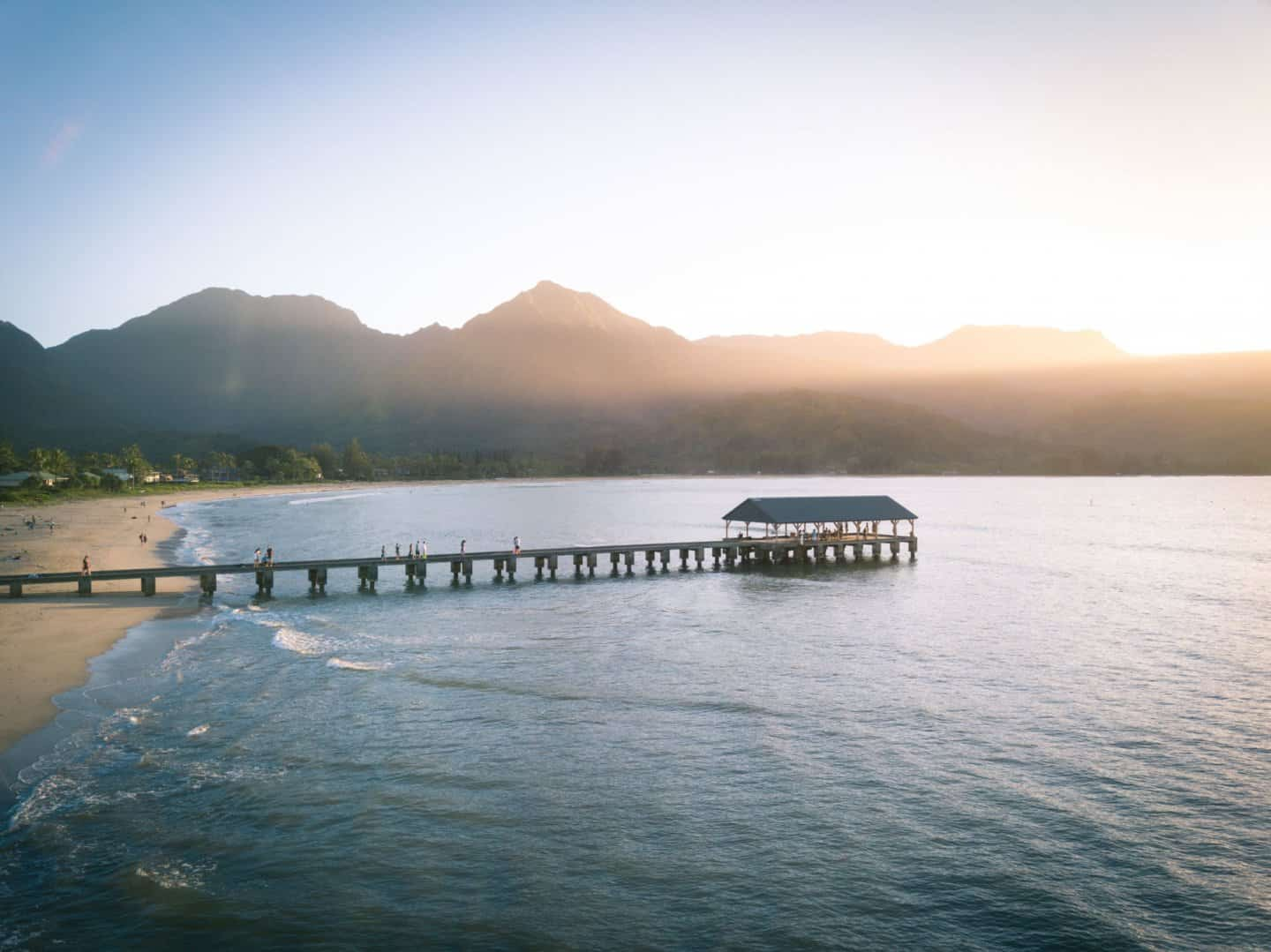 The Hanalei Pier dressed in the colors of a Kauai sunset.