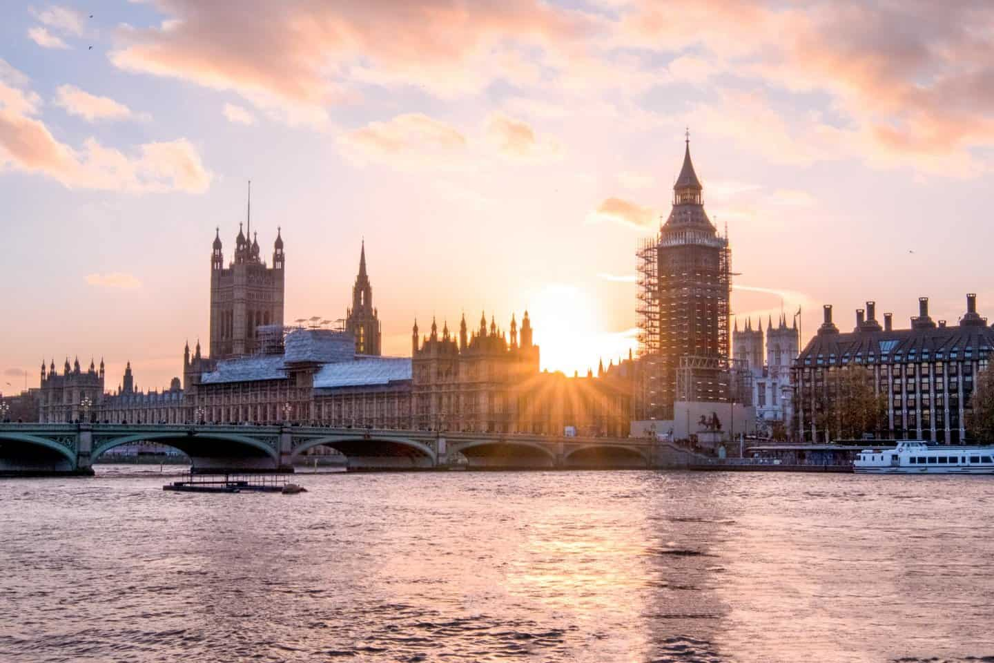Houses of Parliament, Palace of Westminster and Elizabeth Tower (Big Ben) at sunset viewed from South Bank.