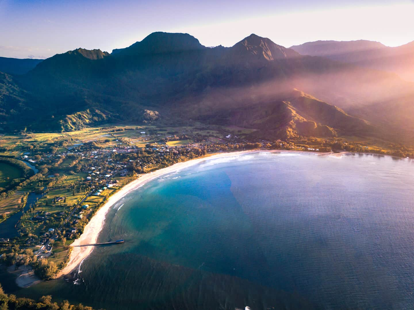 Find a spot on the perfect-crescent beach of Hanalei Bay to enjoy a legendary Kauai sunset.