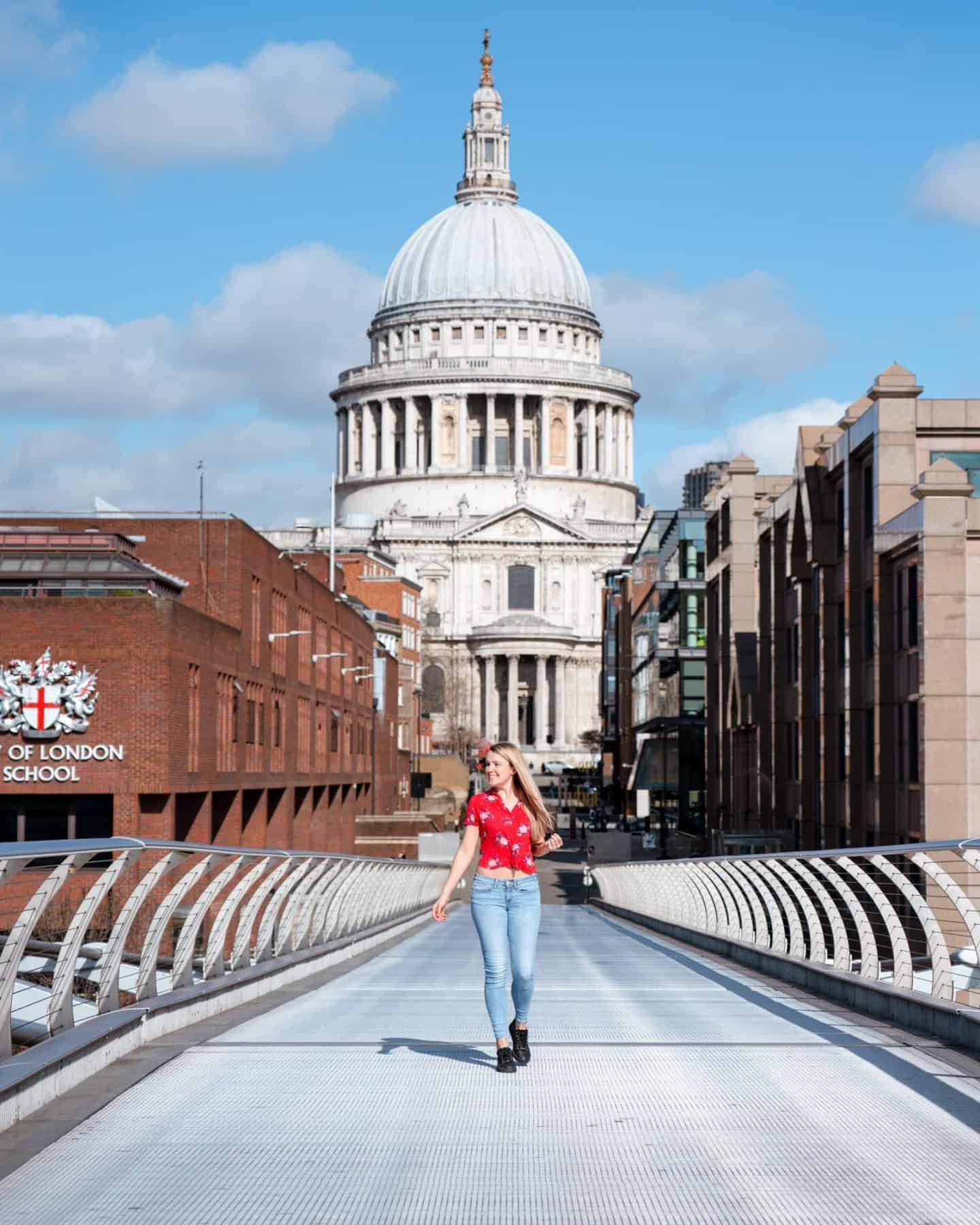 A girl walking along Millennium Bridge with St Paul's Cathedral in the background - two of London's famous landmarks