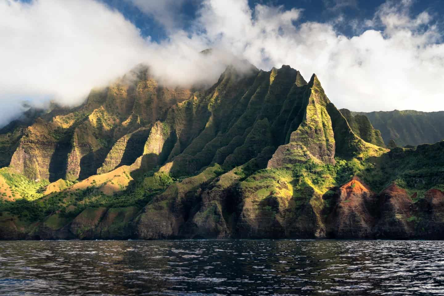 Golden hour light creates beautiful contrast on the Napali Cliffs just prior to sunset in Kauai.
