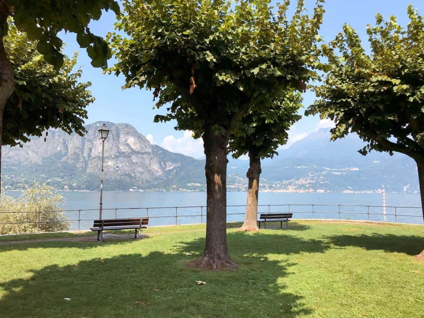 The park at Punta Spartivento provides a perfect spot to relax during a day trip Milan to Lake Como.