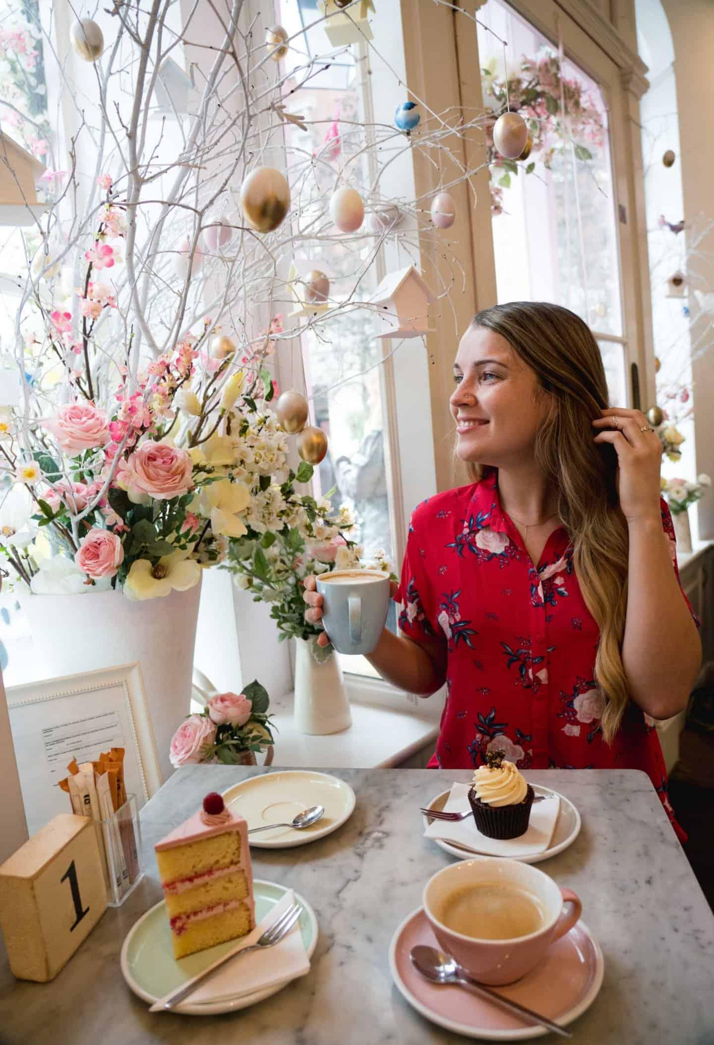 Girl enjoying coffee and cake at Peggy Porschen Belgravia London