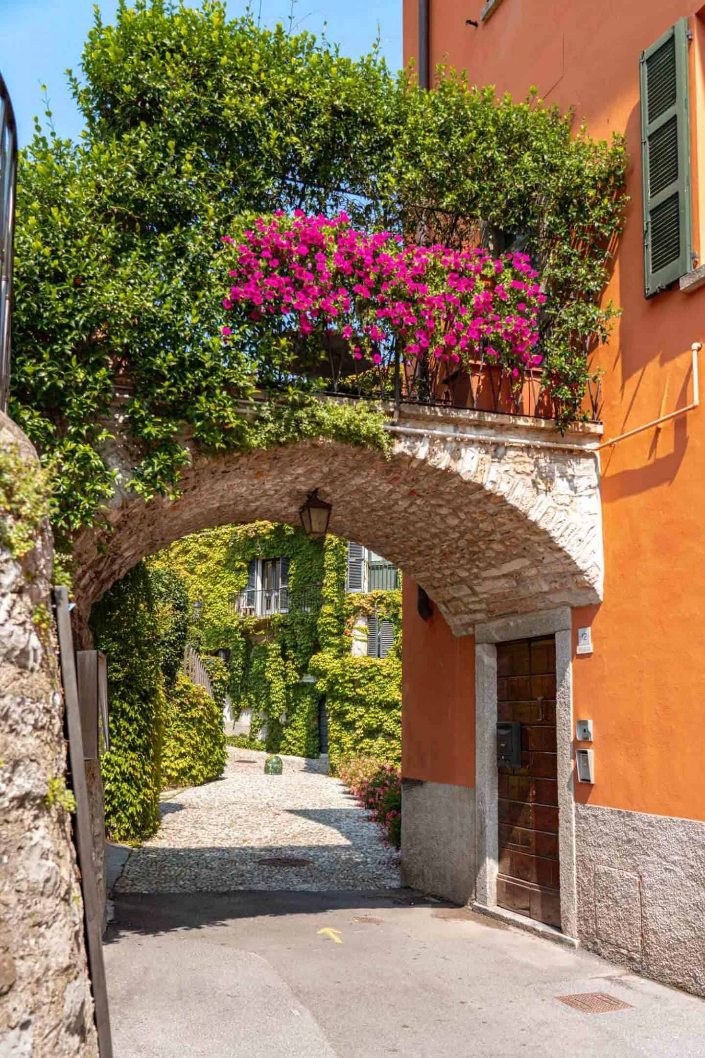 Greenery and flowers adorn an archway in Pescallo, Bellagio