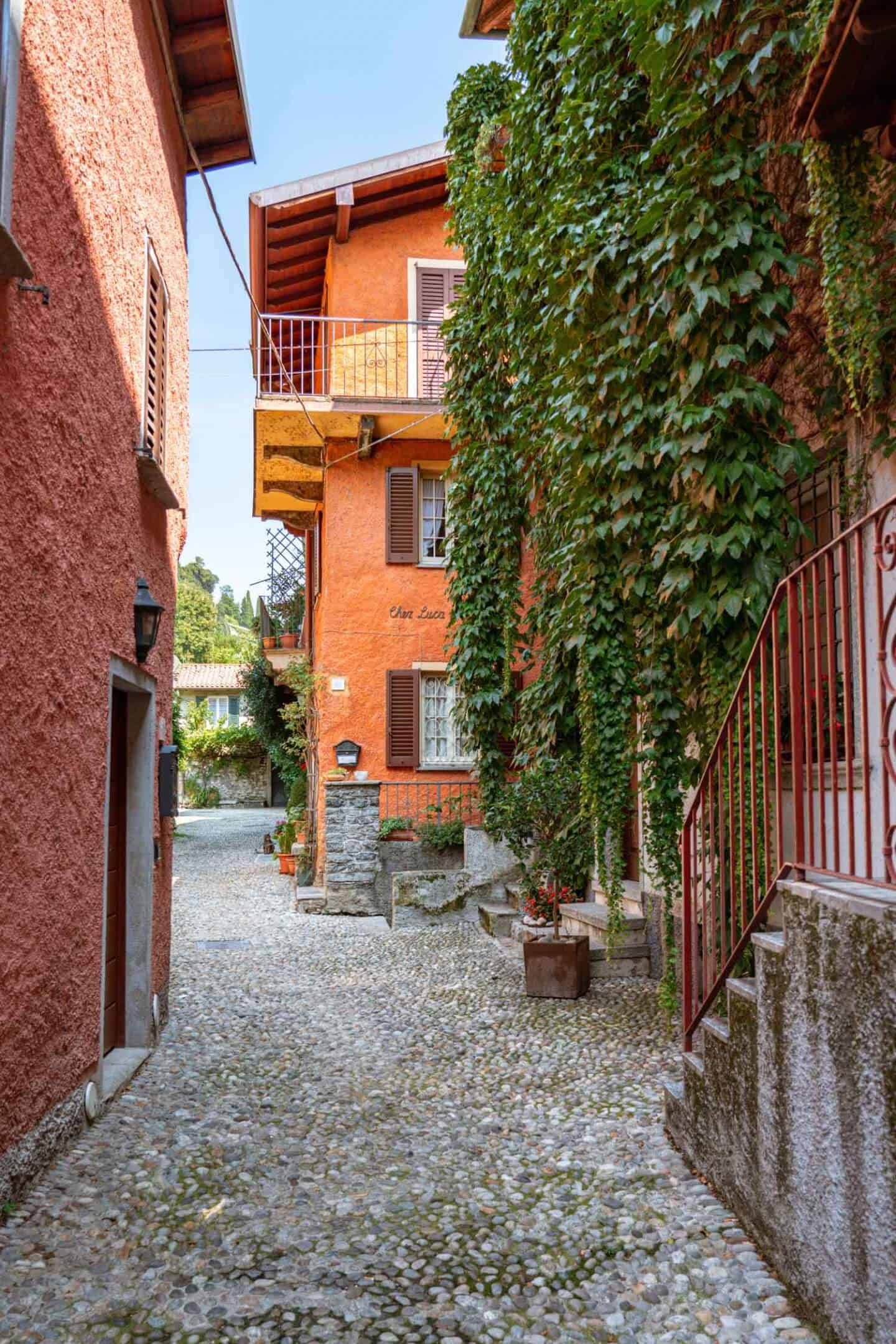 Colourful orange buildings tucked away in Pescallo Bellagio Lake Como
