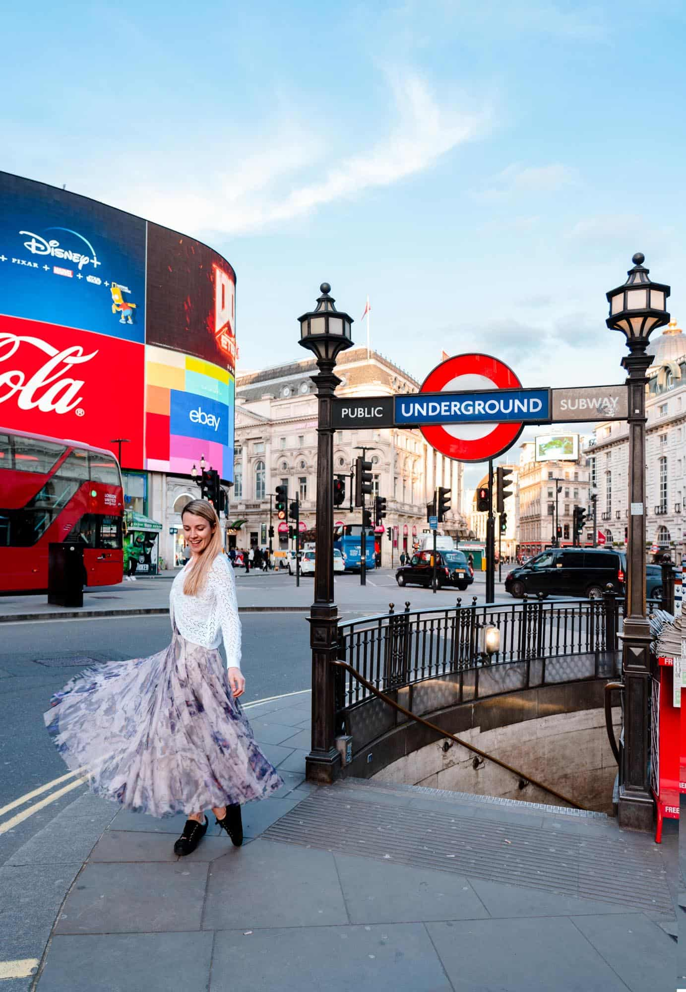 Piccadilly Circus tube station and ad screens are a famous landmark in London