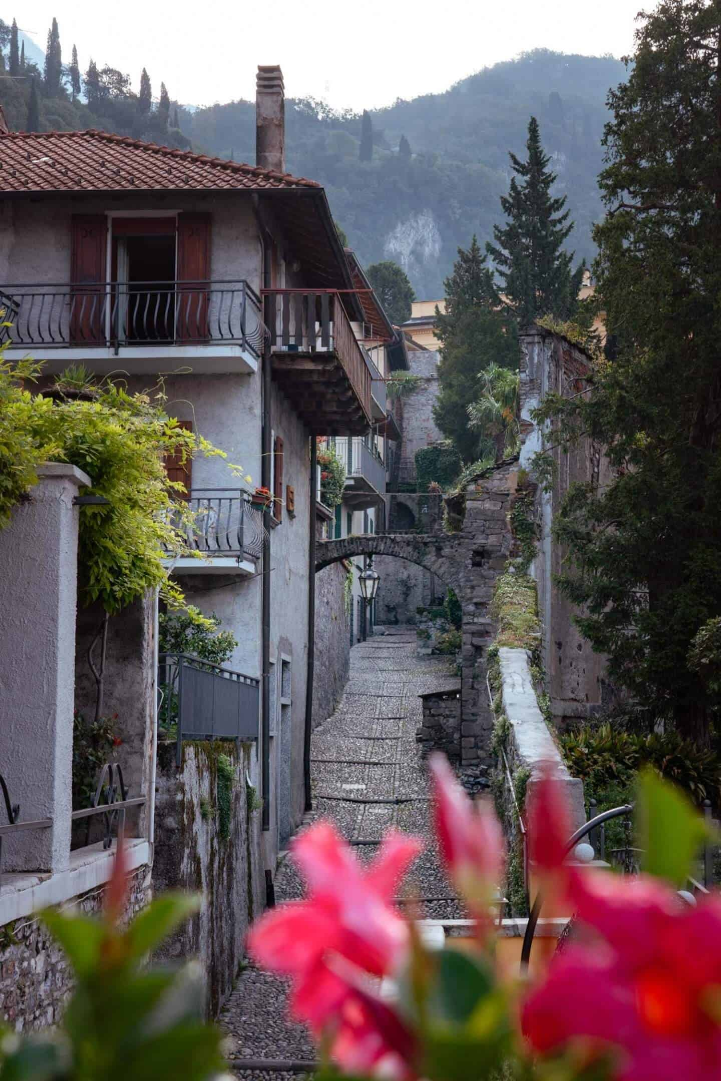 Steep narrow cobblestone streets are characteristic of Varenna, Lake Como, Italy