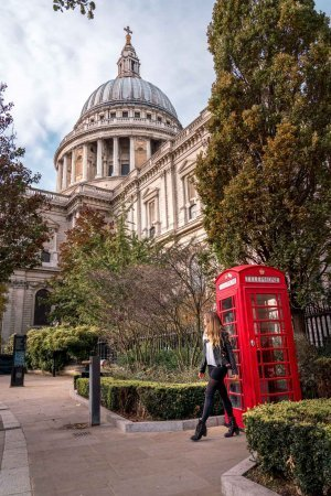 Iconic red London phone box in front of St. Paul's Cathedral creates a perfect Instagram shot