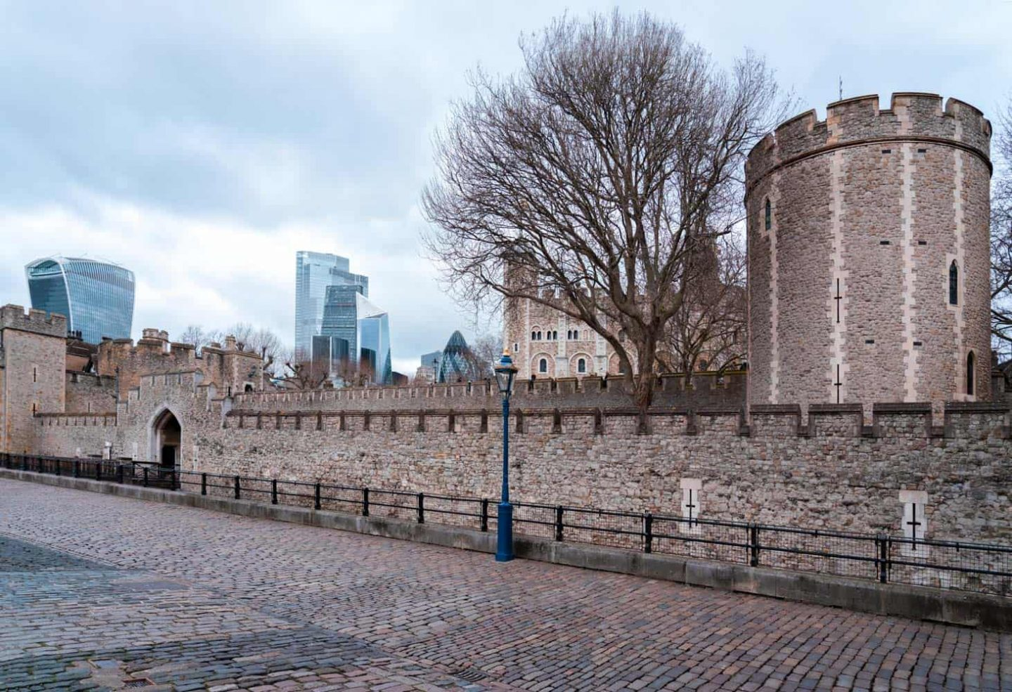 The southern side of the Tower of London as seen from the bank of the River Thames.
