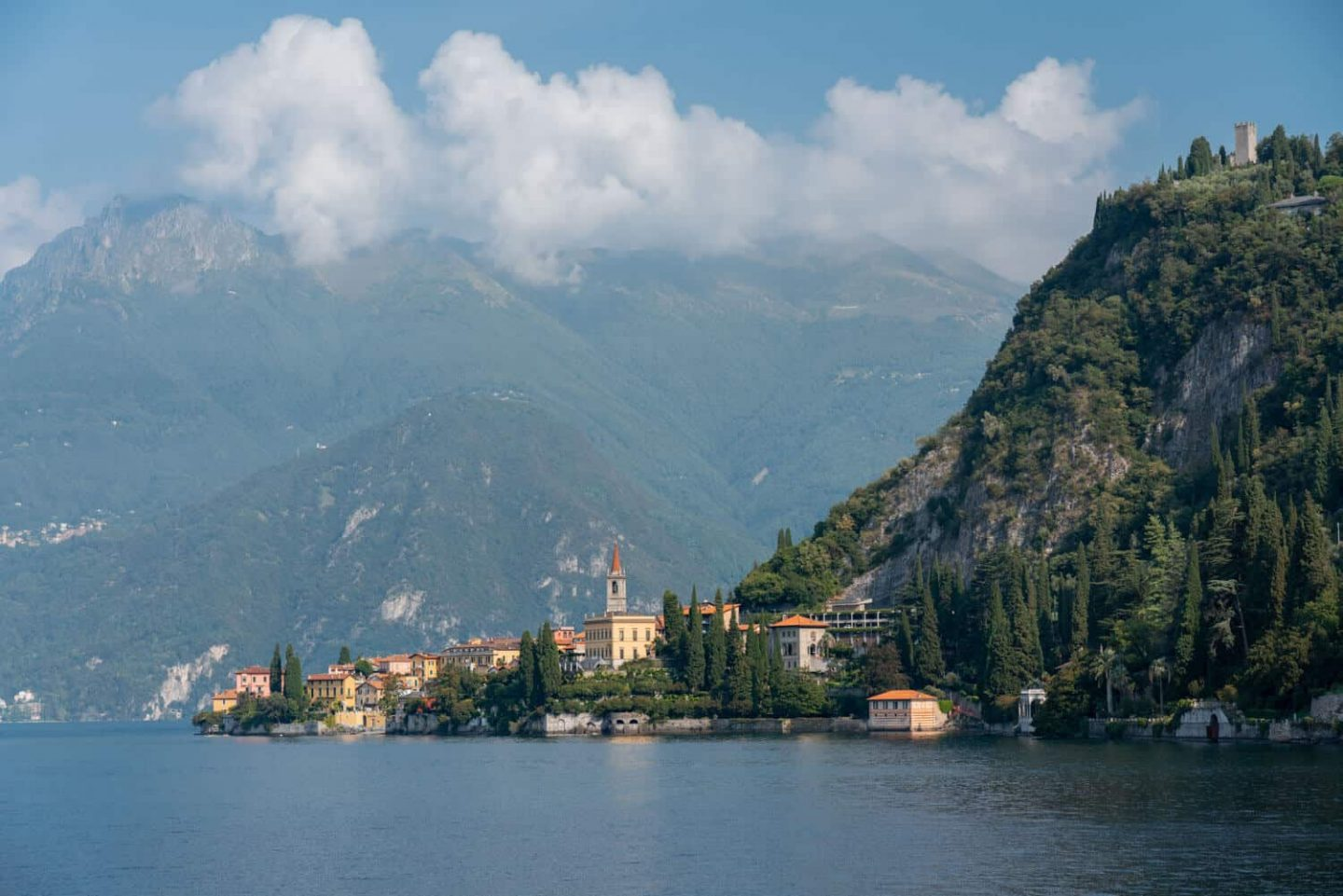 The lakeside town of Varenna nestled against a mountainous backdrop in Lake Como, a perfect day trip from Milan.