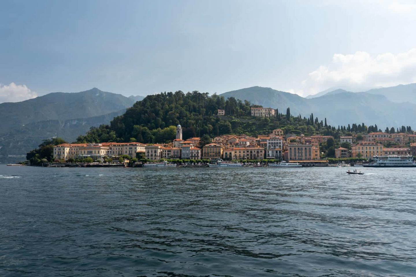 View of the town of Bellagio from a boat on a day trip Milan to Lake Como