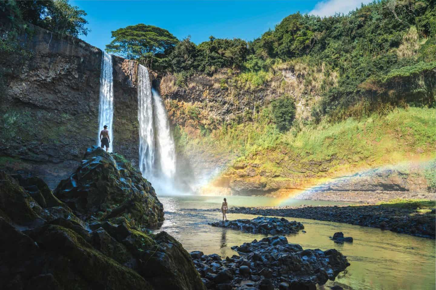 Posing under a rainbow at Wailua Falls in Kauai.
