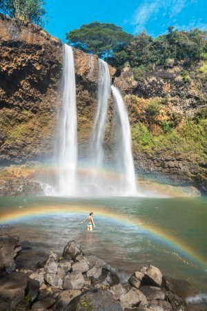 Standing below a rainbow at Wailua Falls in Kauai.