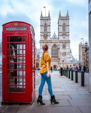 A red phone box in front of Westminster Abbey - two london landmarks in one image