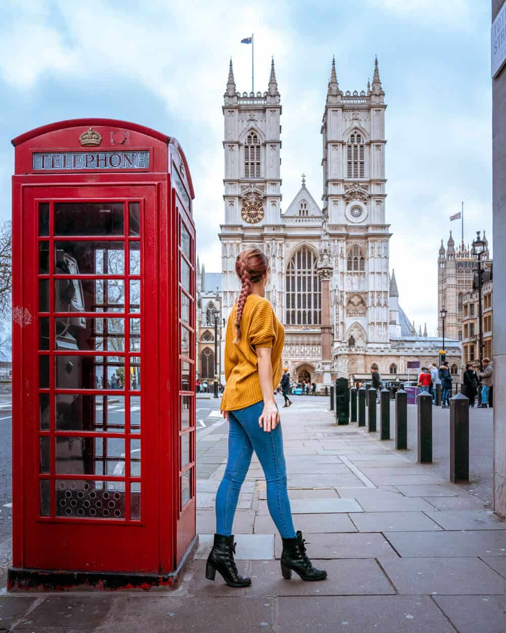 A red phone box provides an iconic foreground for the photogenic Westminster Abbey