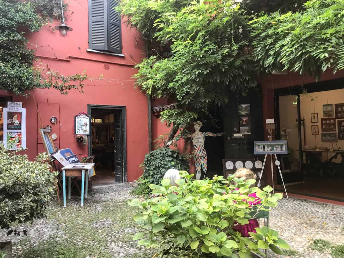 A courtyard with artist's studios in Navigli, a must-see attraction during a 2 days in Milan itinerary