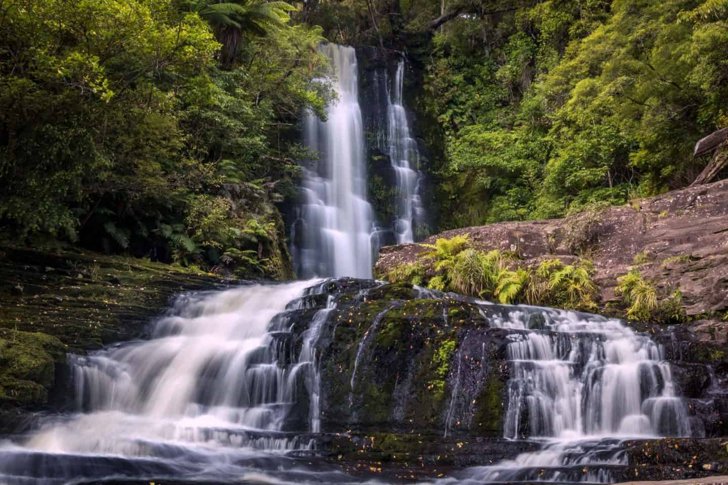 The cascading tiers of water at McLean Falls make it a favorite destination for waterfall photographers in New Zealand.