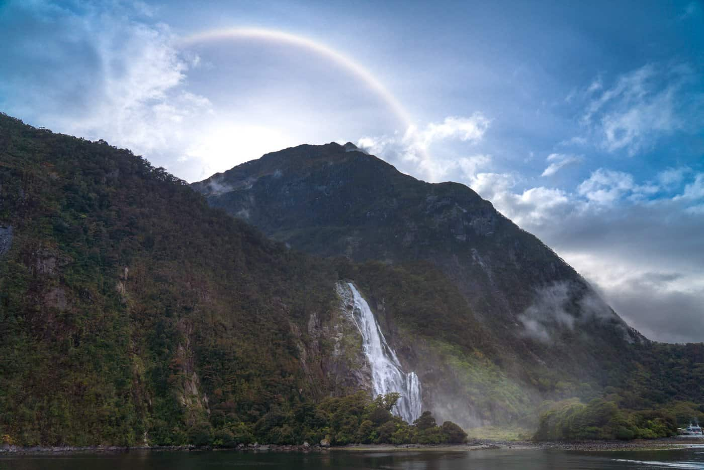 "A ""sundog"" rainbow over Bowen Falls greets us as we return to shore from our Milford Sound day cruise."