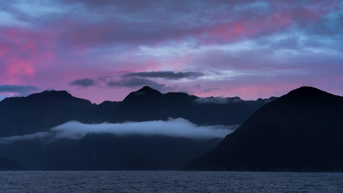 A pink sky at blue hour puts a bow on the first night of our Doubtful Sound cruise.