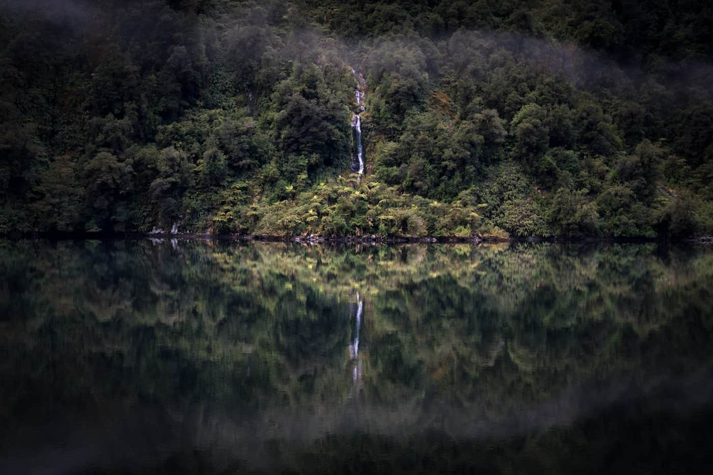 Unbelievably calm waters grace our morning at Doubtful Sound.