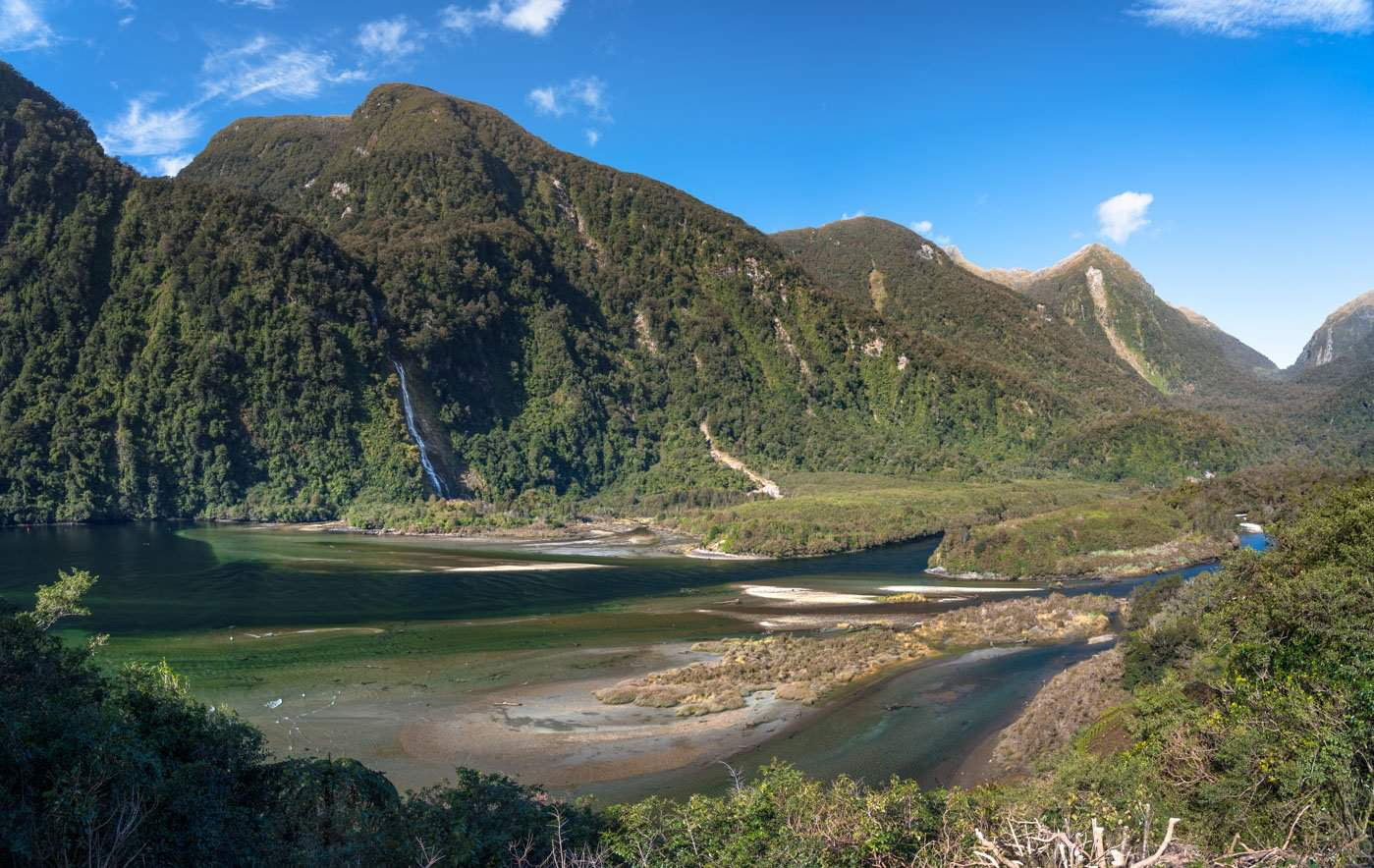 A braided river and waterfall, as seen on the way to our Doubtful Sounds cruise ship.