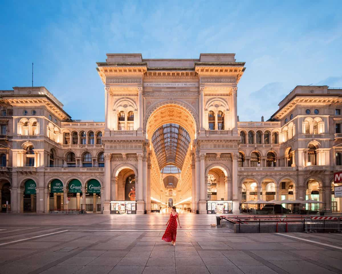 The entrance to Galleria Vittoria Emanuele II from Piazza di Duomo at dawn.