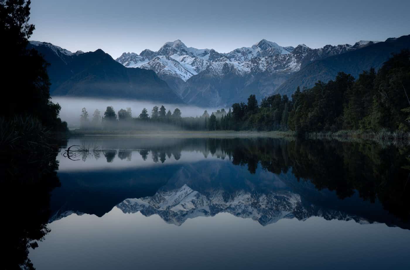Begin Day 6 of your 7 day itinerary at Lake Matheson, famous throughout the South Island of New Zealand for its mirror-like reflections.