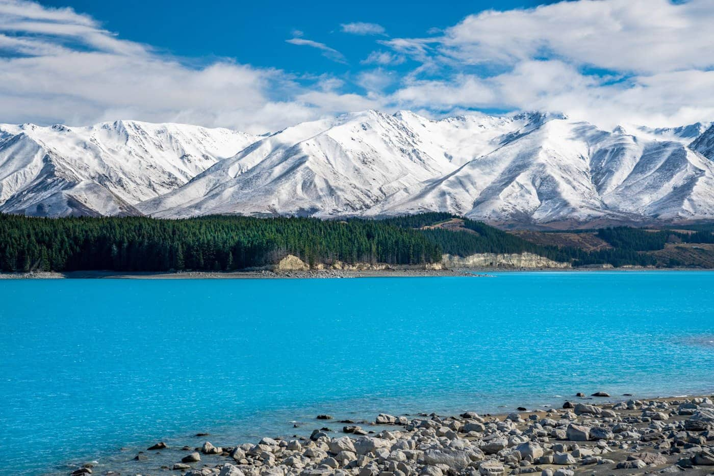 Snowy mountains and crystal clear air define August in New Zealand.