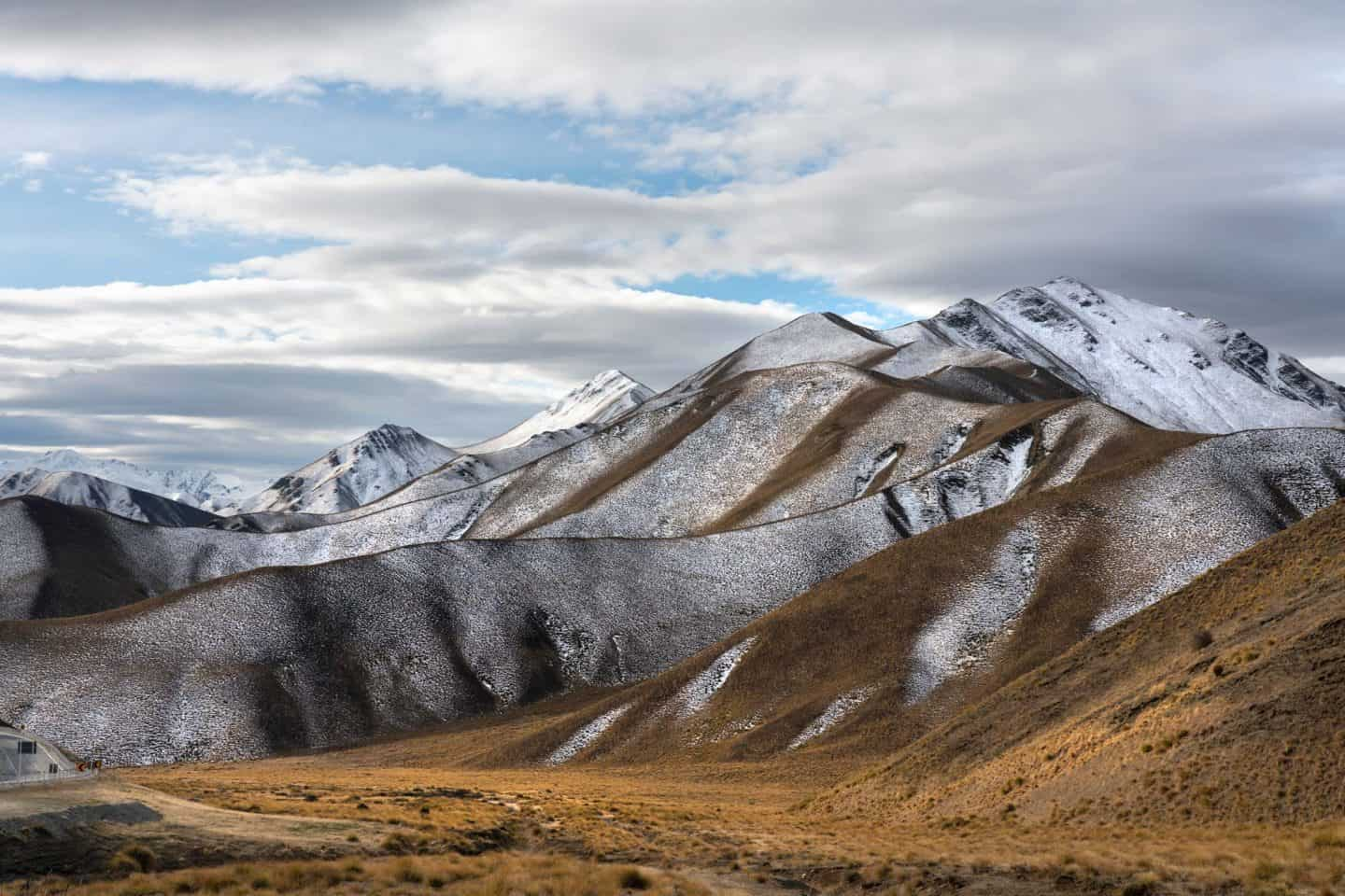 Cascading mountain ranges and fresh snow set the mood for some NZ landscape photography.