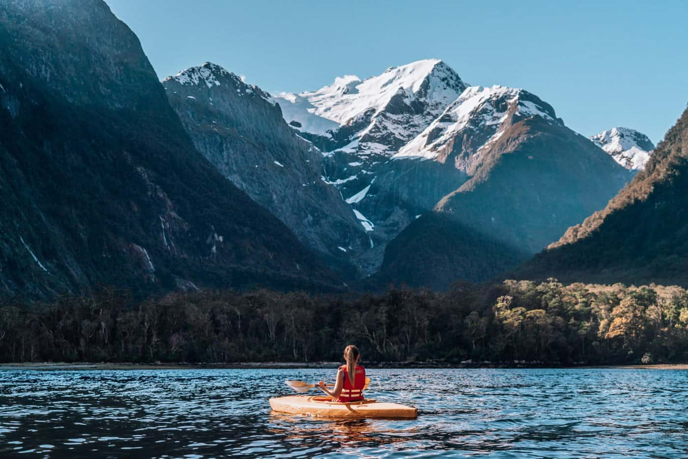 Sophie enjoys some breathtaking views on a kayaking adventure through Milford Sound.