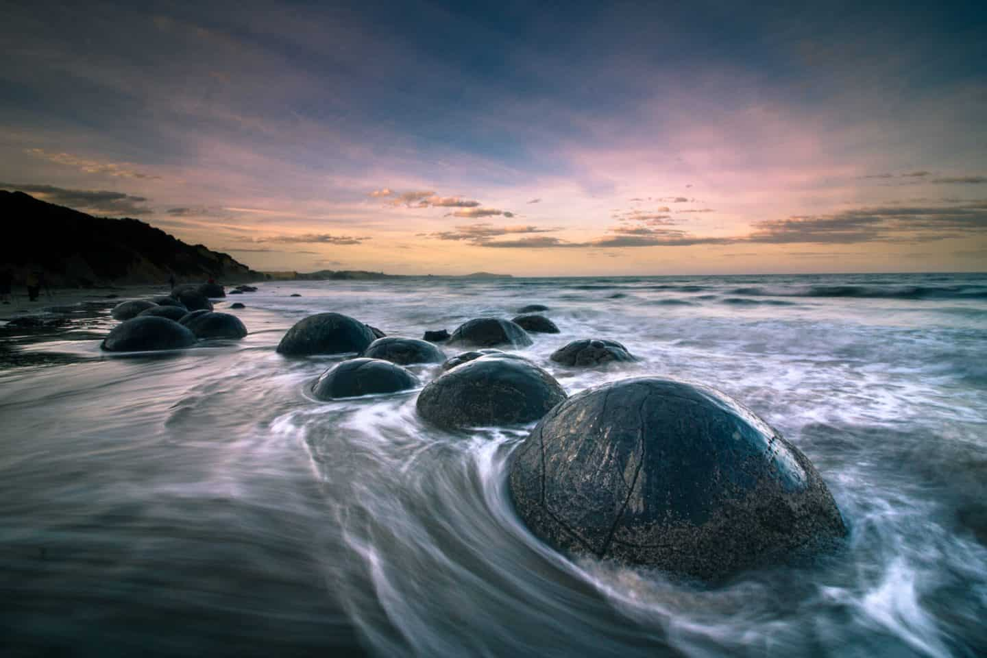 Sunset photography of the Moeraki Boulders.