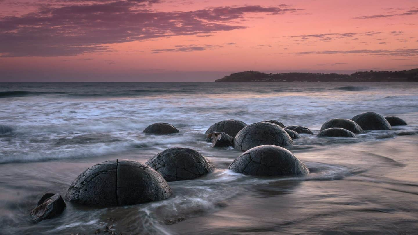 Sunset photography at the Moeraki Boulders is a must for any NZ landscape photography itinerary.