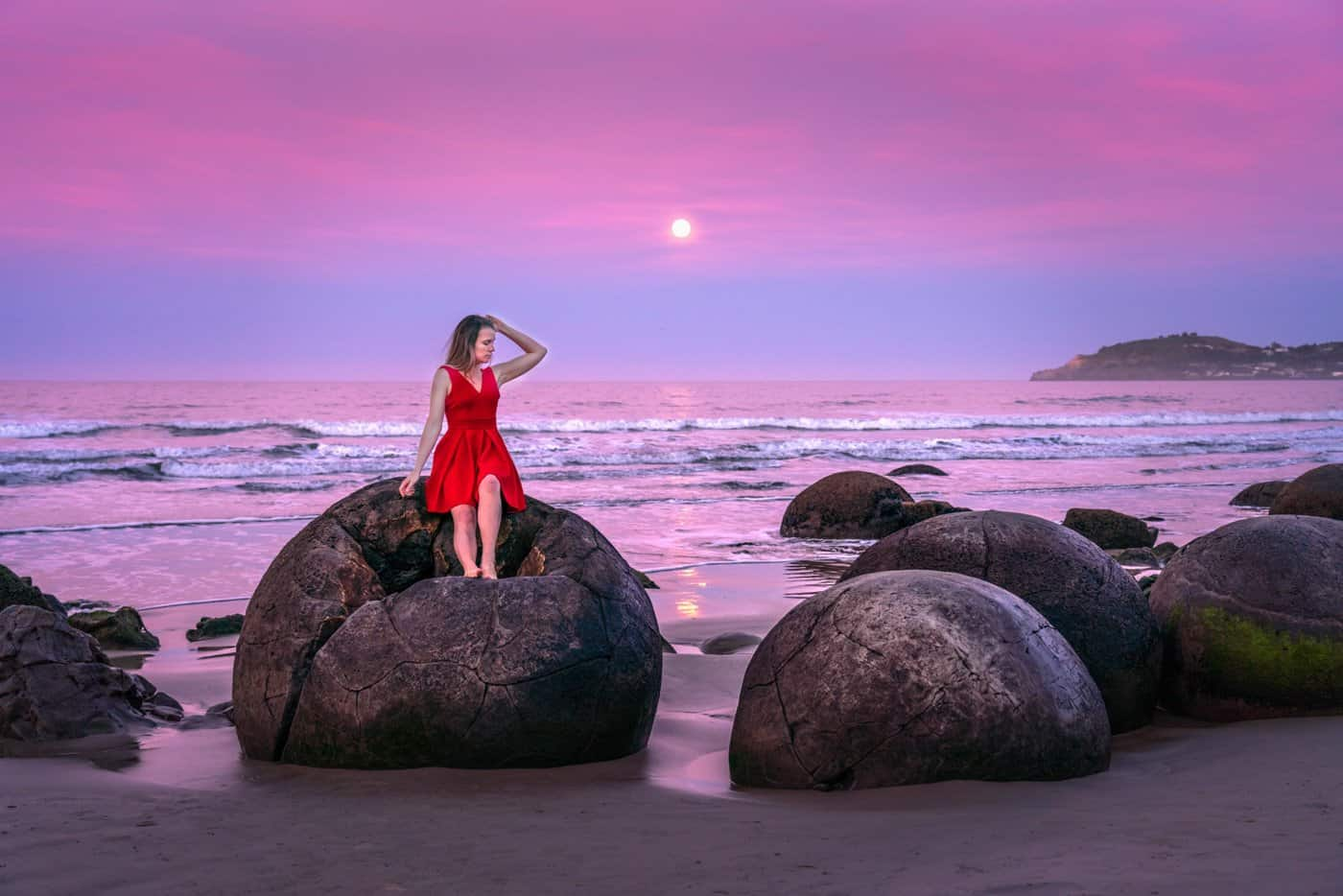 "The moon rises over the Moeraki Boulders; a destination you will experience in our ""Central South Island"" 7-day New Zealand itinerary."