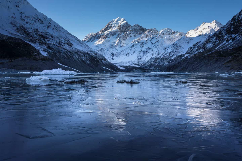 Landscape photography of a frozen Hooker Lake in Mt Cook / Aoraki, New Zealand.