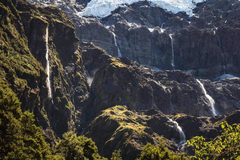 Waterfalls stream down the sides of the Rob Roy Glacier near Wanaka.