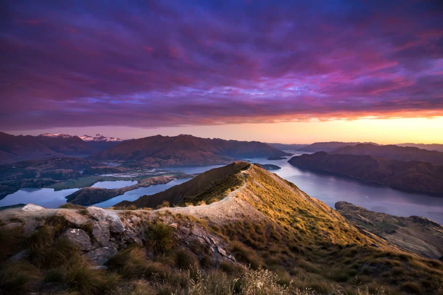 Roys Peak sunrise photography featuring a dramatic, colorful sky.