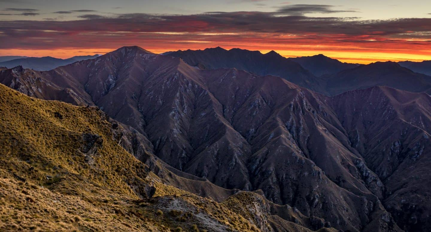 If you are photographing sunset from Roys Peak, go all the way to the top and focus on the mountain-scapes from the peak.