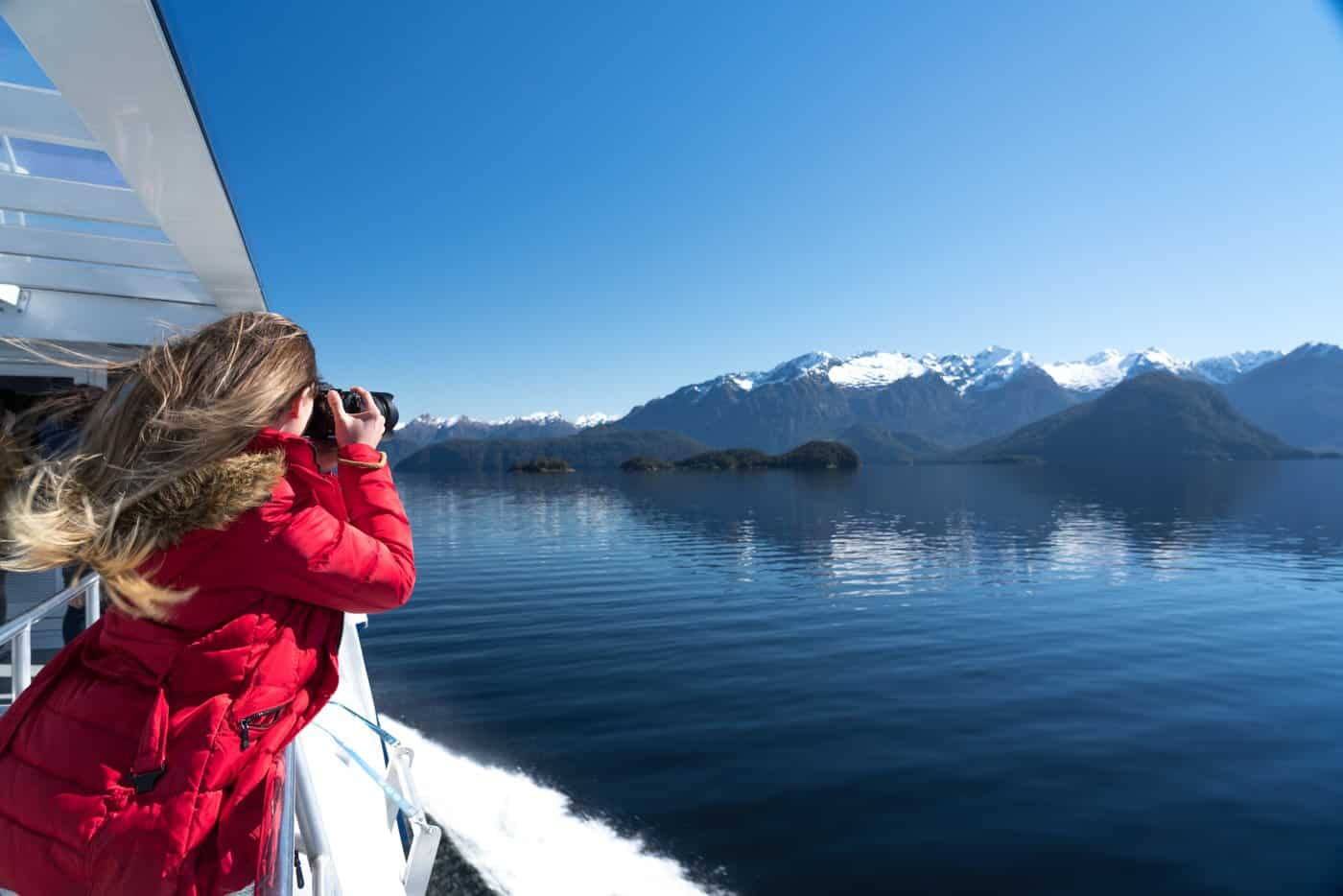Photographing the snow-capped mountains of Manapouri.