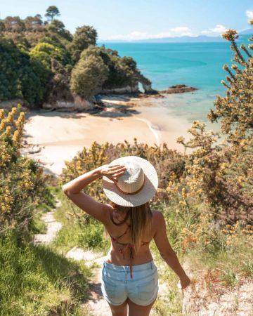 Summer is the best time to visit New Zealand if you want to spend time on the beach!