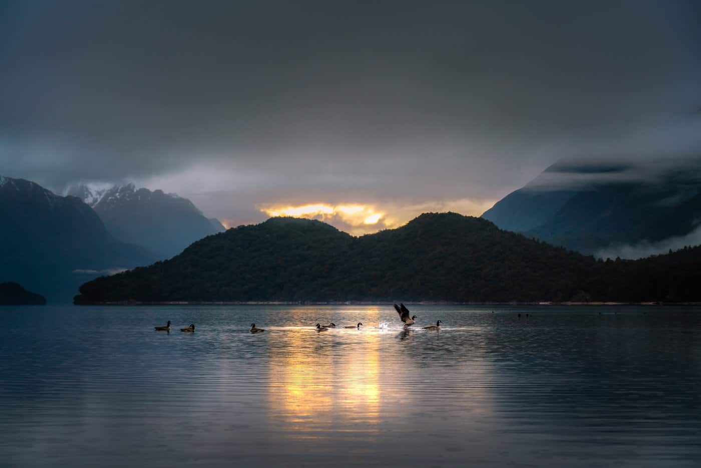 Sunrise on a moody morning in the Doubtful Sound.