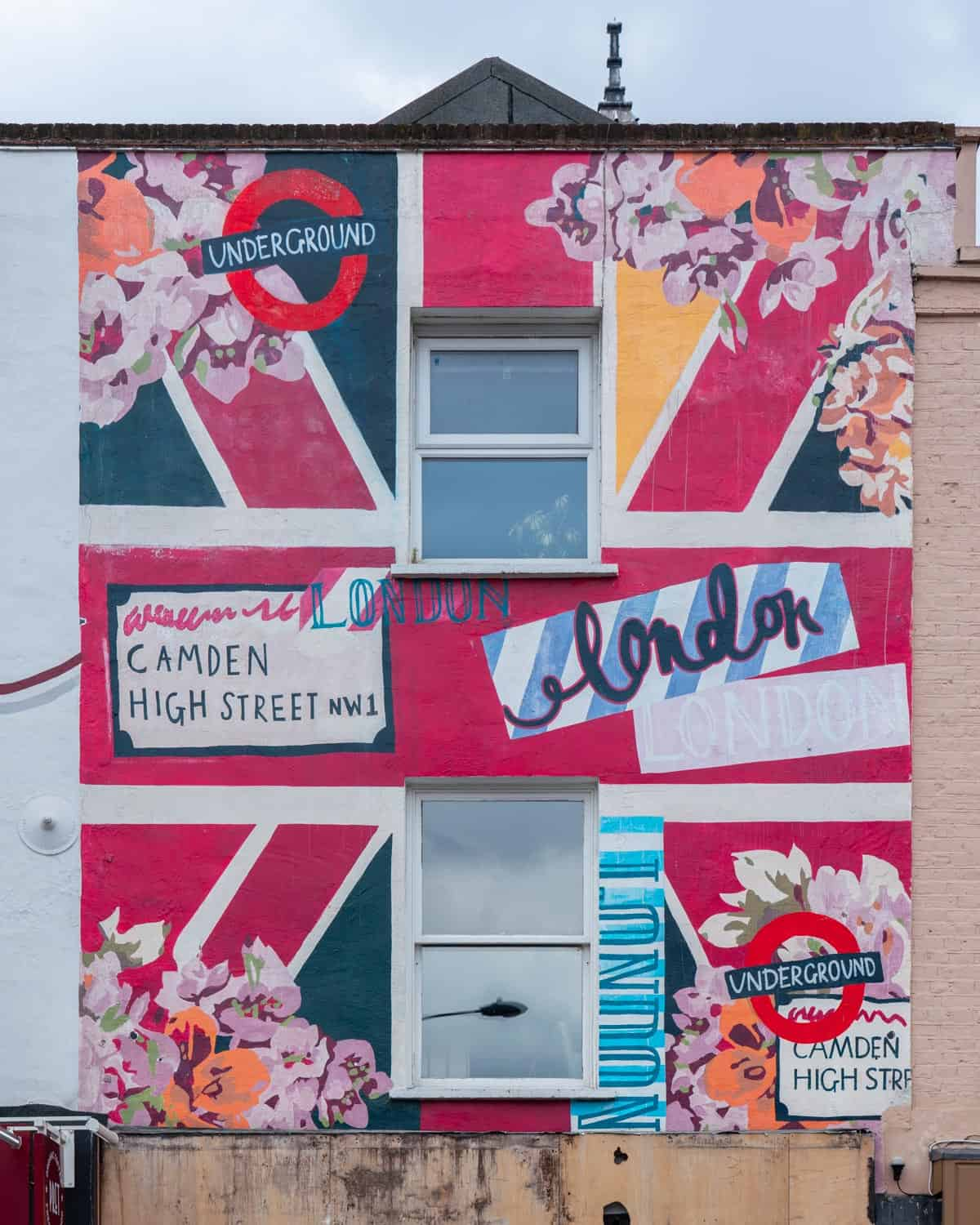Bright painted artwork of a Union Jack and flowers on a shop front on Camden Hight Street